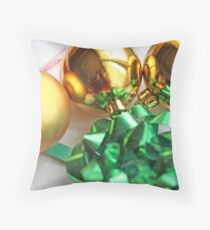 Three gold Christmas balls with green ribbon Throw Pillow
