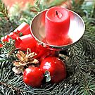 Red candle and Christmas ornaments by pogomcl