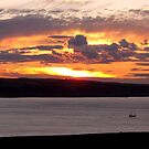 Sunset over Whitby Bay by Gordon Hewstone