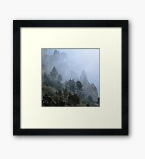 Pines, mist and cliff Framed Print