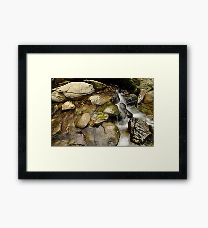 still water flows. Framed Print