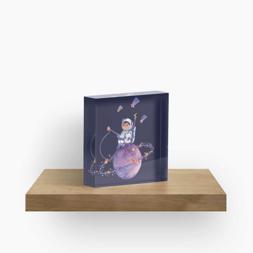Astronaut catching Asteroids on a Star Acrylic Block