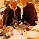Men talk in the market  by Brian Bo Mei