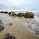 Impressive Moeraki boulders in the Pacific Ocean waves by Sergey Orlov