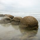Impressive Moeraki boulders and the Pacific Ocean waves by Sergey Orlov