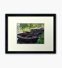 Boats on a lake Framed Print