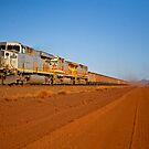 Pilbara Iron Ore Train by Richard  Windeyer