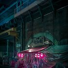 Shady bar under the train track by Guillaume Marcotte