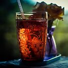 Ice tea and rose by Debbie Stott