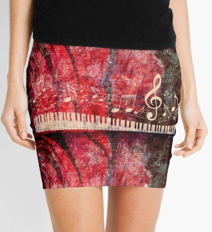 Klaviertastatur mit Musik merkt Grunge 2 Minirock