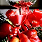 Reflection  of a silver goblet  with  a candle apples  and greens B by pogomcl