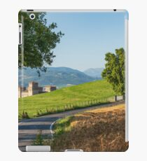 Castle surrounded by green fields and wheat fields in Italy iPad Case/Skin