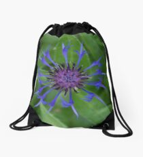 Thin blue flames in a sea of green Drawstring Bag
