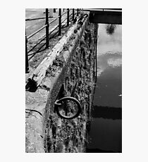 rusty metal mooring ring at the harbour Photographic Print