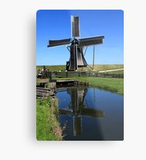 Windmill Reflection In A Pond Metal Print