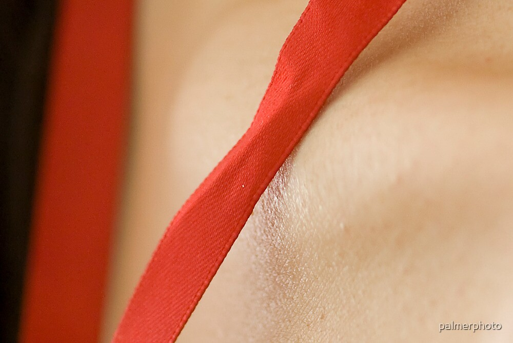 Red ribbon on skin by palmerphoto