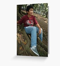 little boy sit down beside the tree Greeting Card