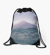The Attraction Of Mountains by Cat Burton Drawstring Bag