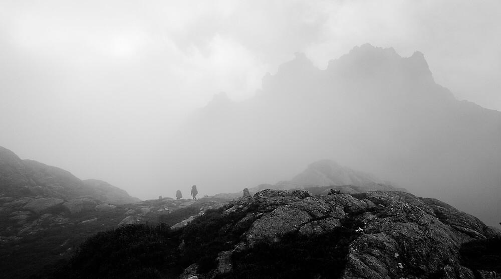 Bushwalkers dwarfed by Mount Pegasus in the mist by Michael Gay