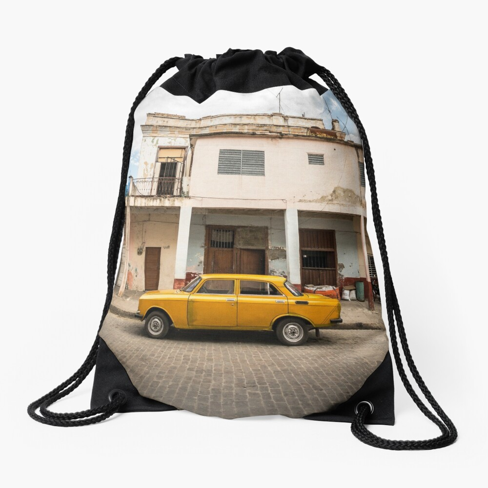 Bright yellow vintage car in La Havana, Cuba. Drawstring Bag