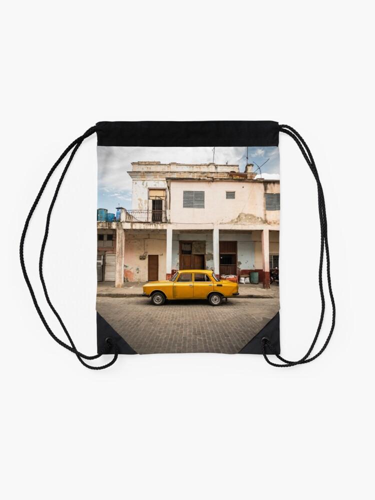 Alternate view of Bright yellow vintage car in La Havana, Cuba. Drawstring Bag