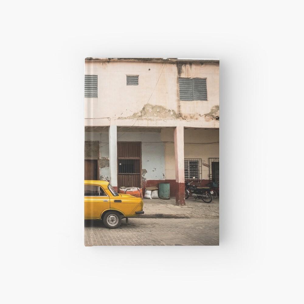 Bright yellow vintage car in La Havana, Cuba. Hardcover Journal