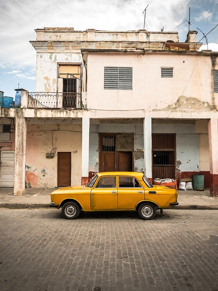Bright yellow vintage car in La Havana, Cuba. by jonathankemp