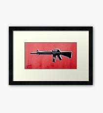 M16 Assault Rifle on Red Framed Print