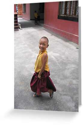 dancing by. young tibetan monk - india by tim buckley   bodhiimages