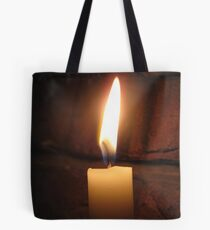 light up the darkness Tote Bag