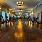 Long wooden conference table by Angela Ferguson