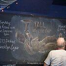 Portrait of the artists' bald head whilst doing chalk mural by John Sunderland
