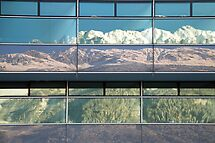 Reflections of the surrounding mountains of Innsbruck by Arie Koene