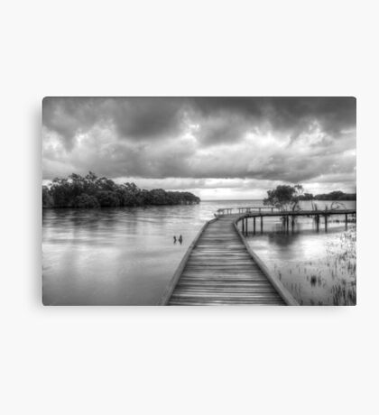 Storm clouds at high tide Canvas Print