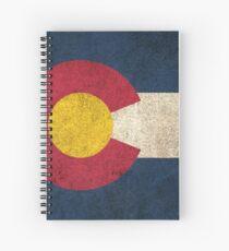 Alte und abgenutzte beunruhigte Weinlese-Flagge von Colorado Spiralblock