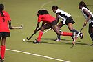 Hockey action by Karue
