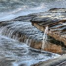 Amongst crashing waves water flows by Jason Ruth