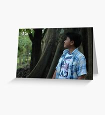 young boy looking to the top Greeting Card