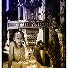 Monk Novice near a pagoda in Phnom Penh-Cambodia. by Michael  Klinkhamer