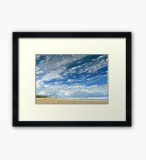 A Buffeting on the Beach Framed Print