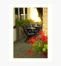 Red flowers and cofee tables Art Print