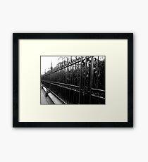 Black fence Framed Print