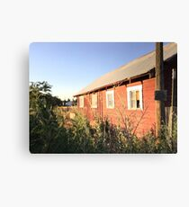 Abandoned old red barn with rusty tin roof Canvas Print