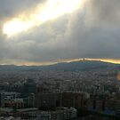 Sunset over a cloudy Barcelona city by Joy Williams