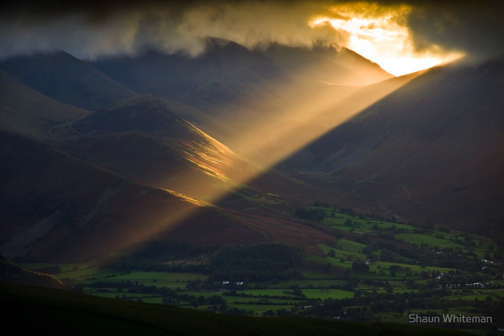 Golden rays on distant fells by Shaun Whiteman