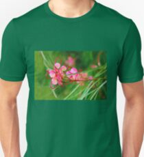 Floral background of grass and red flowers  T-Shirt