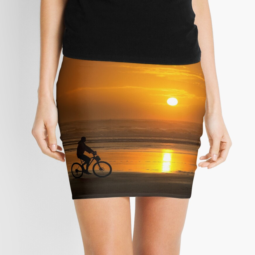 Silhouette of a cyclist along Cannon Beach Oregon Mini Skirt