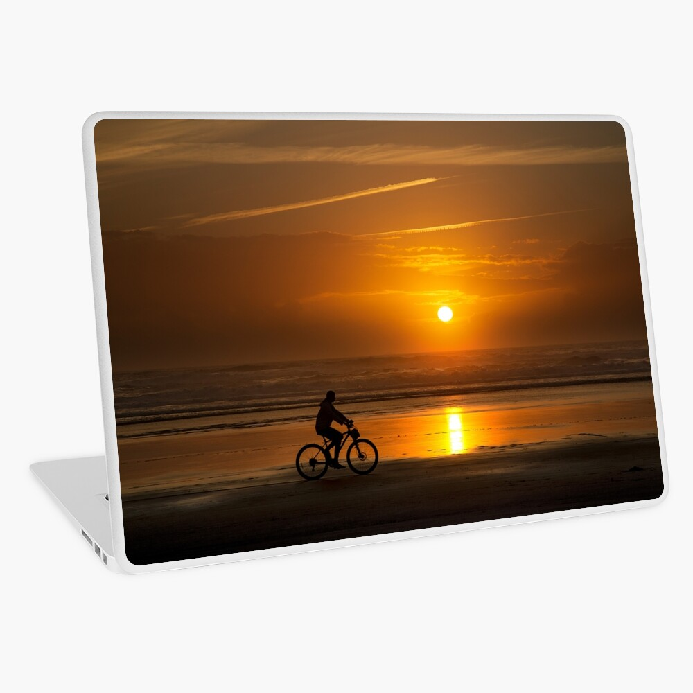 Silhouette of a cyclist along Cannon Beach Oregon Laptop Skin