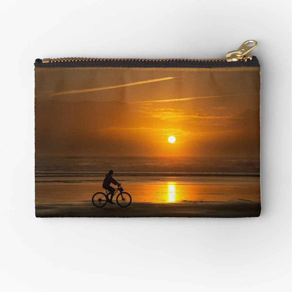Silhouette of a cyclist along Cannon Beach Oregon Zipper Pouch