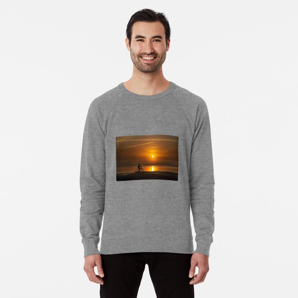 Silhouette of a cyclist along Cannon Beach Oregon Lightweight Sweatshirt
